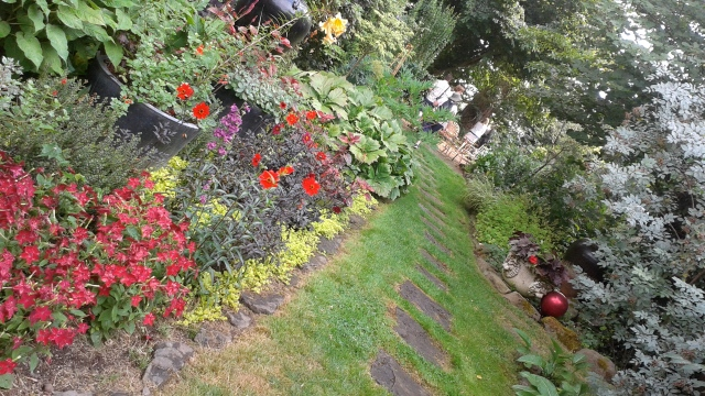 More formal plantings line the entrance path...