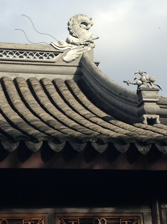 I love the roof tiles. And, I learned that the wedge-shaped tiles along the drip line are called 'bat tiles'.