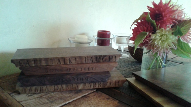 But wait! Those aren't books! They are some of Richard's work - polished wooden slabs with inscriptions. How cool is that?!!