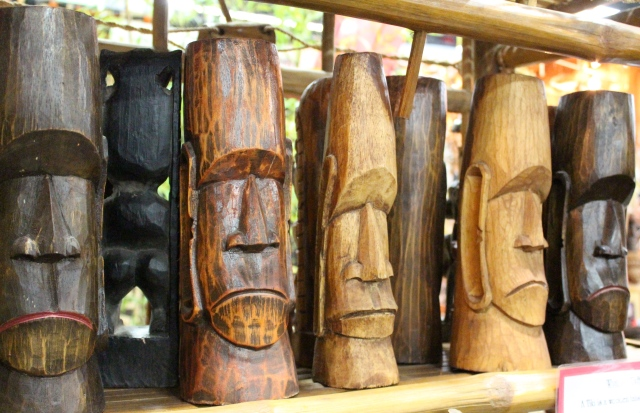 Fun faces carved out of bamboo.