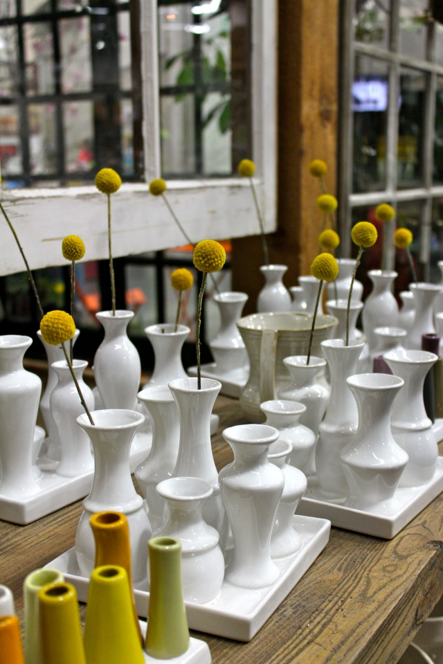 Outside of it, a collection of white vases, each sporting a single Billy Ball - or Craspedia. Simple and stunning!