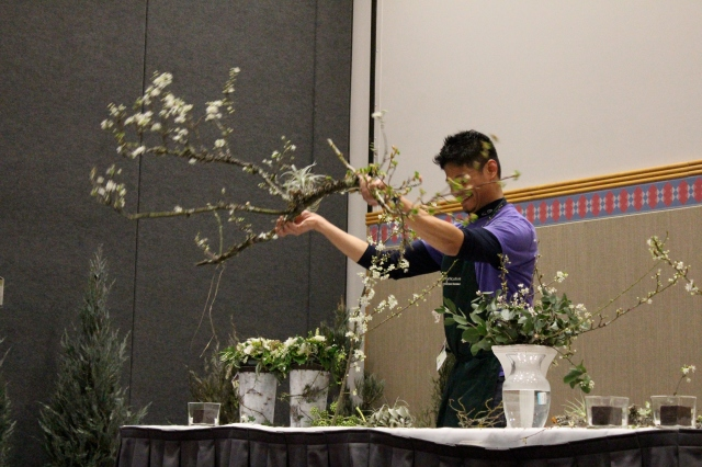 "After Laura left, I spent most of the remaining afternoon listening to a few of the many talks offered throughout the day. Here is Riz Reyes talking about arranging flowers, and demonstrating how he does it. ""Think of it as planting a garden"", he said."