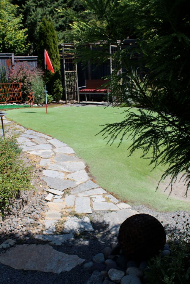 ... Rick's putting green, where he perfects his technique.