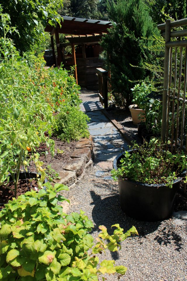 The path will take you up to the top corner of the property. Turning the corner and following the fence back down again, will take you through the vegetable garden, and eventually to the outdoor kitchen. At the lower entrance to the vegetable garden is...