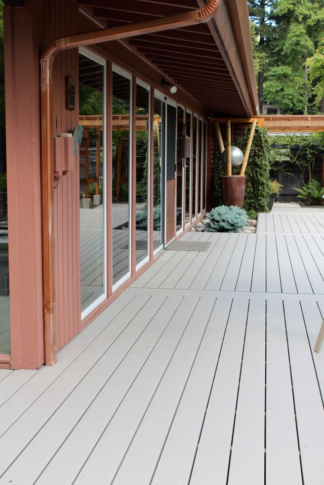 At 1,100 sf, the house itself is not large, but each side opens onto generous outdoor spaces  that in turn takes you further out into the garden. The large Trex deck takes you from the front gate to what over the years has become the dedicated front door - a glazed slider that is concealed in a facade of floor-to-ceiling glass expanses below the generous eaves. Can you imagine  how wonderful the view is from inside the house?
