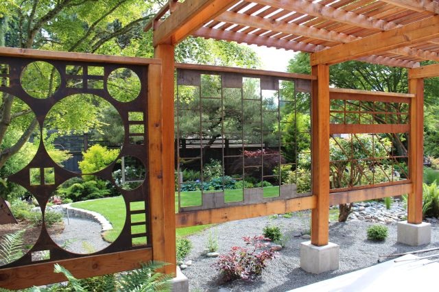 ... you walk through this fabulous scrap metal arbor. This marvelous construct replaced the wisteria, and is the work of Laurel Hedge Landscape Design. Those of you who have visited me, and seen the scrap steel I use around my home will not be surprised to hear that this made me realize I had found a kindred spirit.