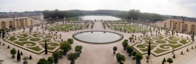 This parterre from Versailles is flatter still. The hedges have been nearly completely eliminated. Photo from Wikimedia, licensed under the Creative Commons Attribution-Share Alike 2.0 Generic license.