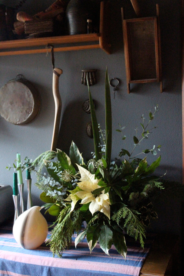 This was the one I settled on, and finally submitted. I used leaves and flowers of a variegated Fatsia japonica, Eucalyptus, and your more traditional Christmas fare for this one.