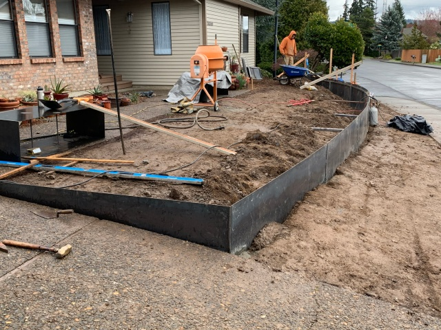 Metal retaining wall installation